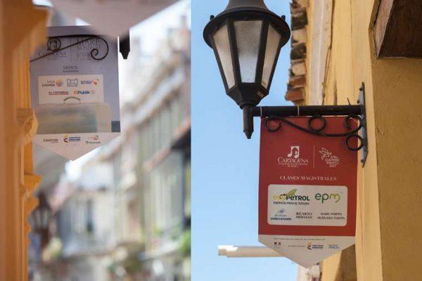 Banderines con publicidad del evento, y logo de la marca de los patrocinadores